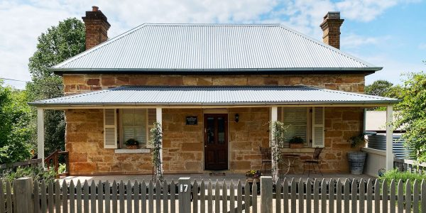 Sandstone Cottage in Berrima with rustic picket fence